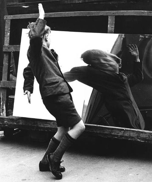 """Reflection; fun; child's play; distortion; perception vs reality; perspective; clarity """"the boy and the distorting mirror"""", rotherham, 1960, by john chillingworth"""