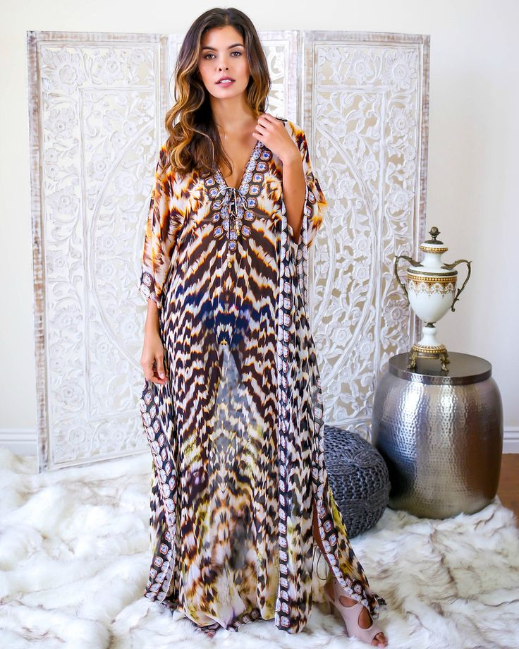 Moroccan Kaftan  Chic, wordly and possibly the most fabulous addition to your wardrobe. Floor length. Wear a small slip under this when you want to go to dinner or layer over your swimsuit poolside. Channel your inner Kyle Richards in this fabulous floor length kaftan with on trend lace up detailing, beautifully printed for timeless vacation wear.