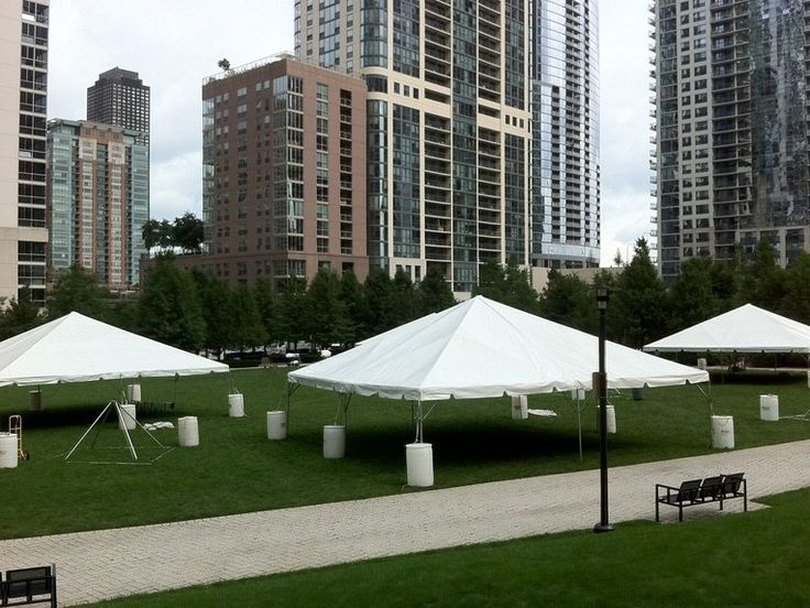 20x20 Festival Tent With Water Barrels From House Of