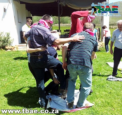 JHI Properties doing the Magic Carpet team building exercise is part of TBAE's Corporate Fund team building activity.