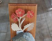Bookend with Wood Carved Crimson Flowers peaking around a Lake Superior rock--useful as a traditional bookend or as a shelf art accessory