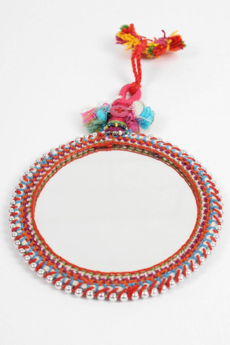 The Boho Beaded Mirror, a beautiful Indian wall mirror decorated with a crochet frame, silver or gold beads, tassels & buttons. These traditional boho mirrors look fabulous hung in an eclectic cluster