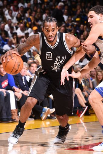 Kawhi Leonard scored a career-high 35 points and the San Antonio Spurs emphatically spoiled Kevin Durant's long-awaited Warriors debut Tuesday with a 129-100 rout that sent Golden State fans for the exits early on opening night. Durant had 27 points and 10 rebounds, but little looked in sync for