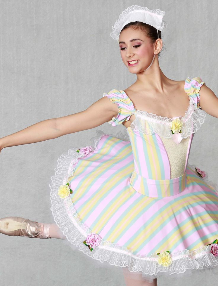 """MIRLITONS - Delicately devine! Our """"Flexi Fit"""" classical ballet bodice leotard with vibrant pastel striped spandex and delicate yellow sequins. 8 layer tutu with lace panty and striped basque and plate. Lots of dainty lace and flowers all around, headpiece included. Made in sizes child medium thru adult. CHARMING!"""
