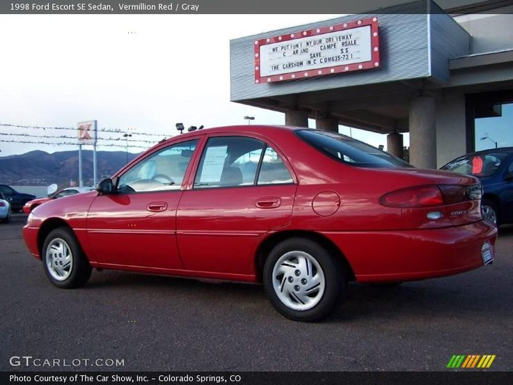 1998 Ford Escort - the cheapest thing on the car lot and our first new car. Bright red with a manual transmission. Great air conditioner and would go over 100mph with little effort...it just took a while.  Decent car.