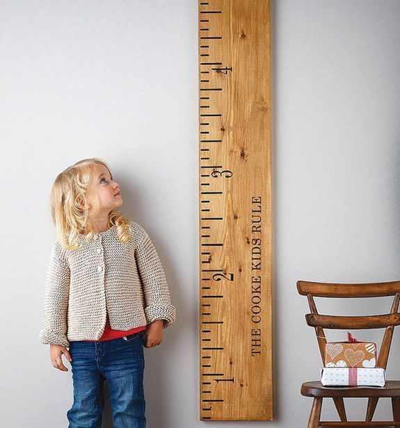 Track your child's height and teach measurements with a giant ruler. Markings are stenciled on. A do-it-yourself idea?