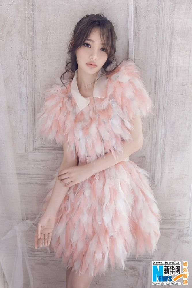 Chinese actress Li Xiaolu  http://www.chinaentertainmentnews.com/2015/07/li-xiaolu-poses-for-fashion-magazine.html