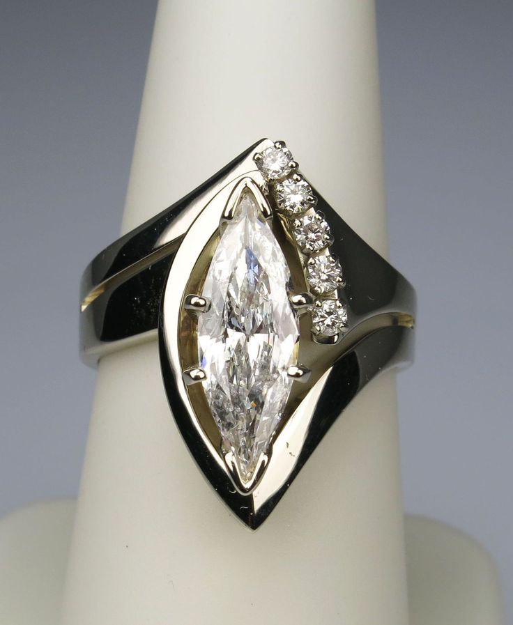 #UniqueEngagementRing with a Marquise Cut Diamond.  This is a gorgeous Designer Engagement Ring