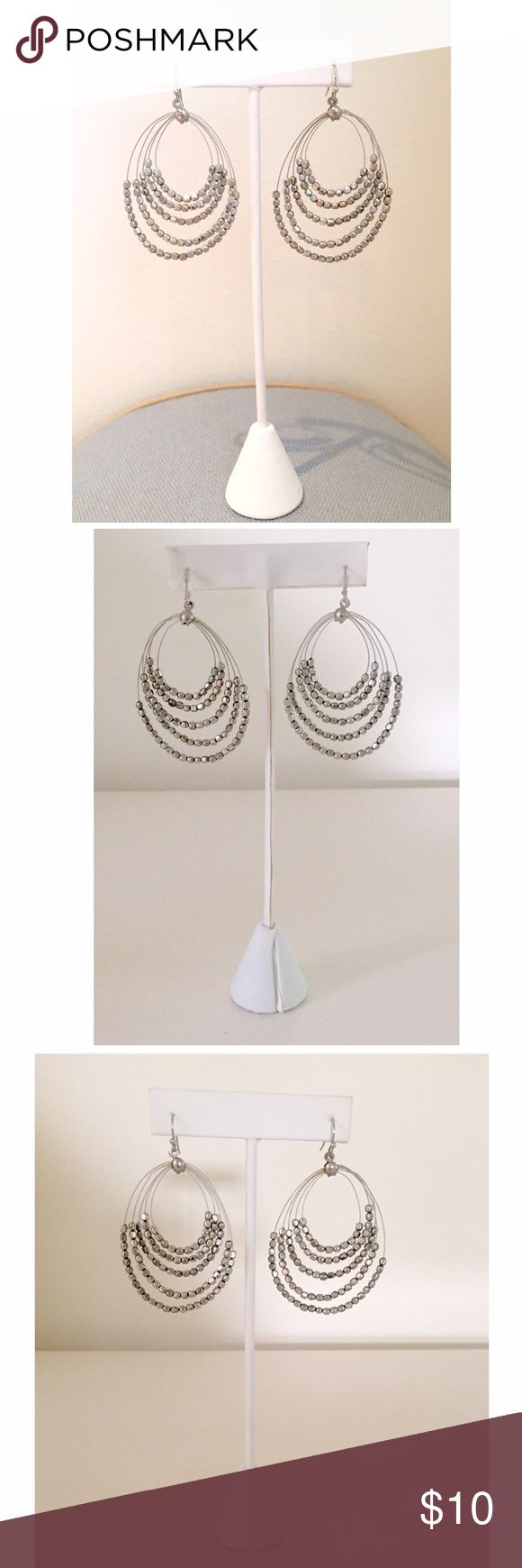 """Silver Grey Nugget Beaded Thin Wire Earrings Simple but beautiful earrings! Purchased at a boutique. Brushed silver grey tone nuggets slide along 5 tiers of thin wire. Any perceived asymmetry to the earrings can be easily adjusted w/ the thin wire. These were in storage. Approximately 1-5/8"""" at its widest point and overall drop length is approx. 2-3/8"""". Versatile set of earrings which can be day or night! Jewelry Earrings"""