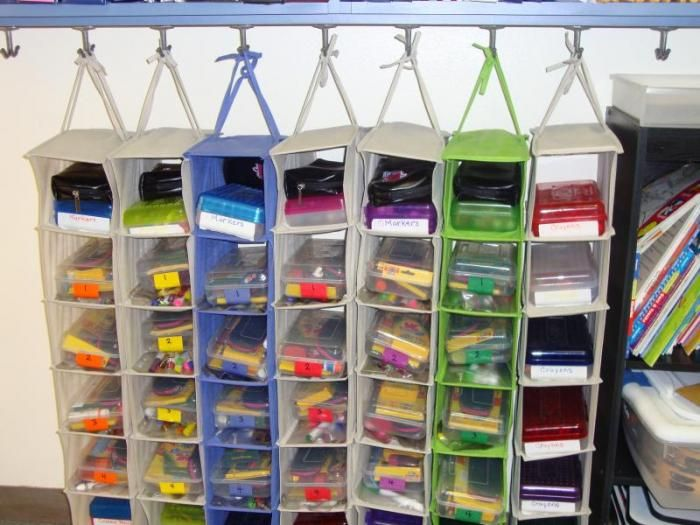Wonderful Idea....Shoe Hanger Storage for Student or Teacher stuff. This will work prefect for homeschooling, make use of coat closet and out of sight when school isn't in session. :) You could even have one for each child with each pocket for a different subject.