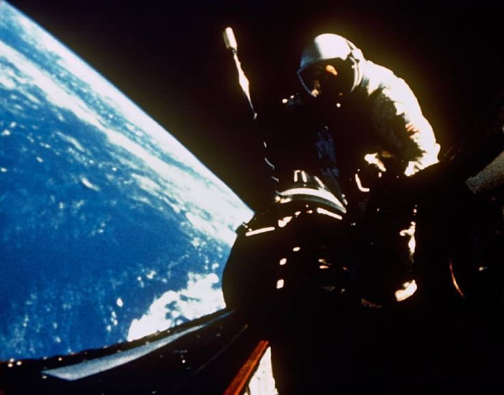 13 Sept. 1966 - Astronaut Richard F. Gordon Jr., pilot for the Gemini-11 spaceflight, returns to the hatch of the spacecraft following extravehicular activity. This picture was taken over the Atlantic Ocean at approximately 160 nautical miles above Earth's surface. Photo credit: NASA