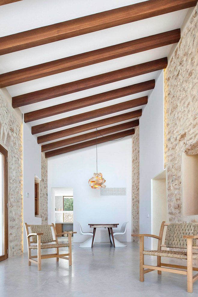 Contemporary remodel and extension of Can Manuel d'en Corda traditional stone-wall house located on the Spanish island of Formentera by Maria Castello Martinez Architects