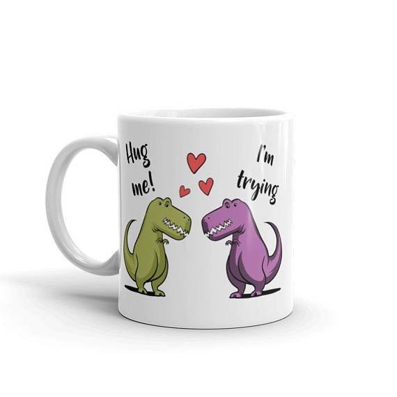 BUY NOW the latest addition to Moon Ape #etsy shop: Hug Me T-Rex - Dinosaur Love - Dinosaur Couple - Sad T Rex Mug - Funny T Rex - Dinosaur Cup - T Rex Mug - Dinosaur Coffee - Dinosaur Joke #valentinesdaymug #valentinesdaygift #funnydinosaur #dinosaurmug #funnytrex #dinosaurlover #romaticmug #moonapetees