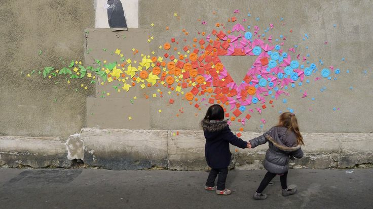 Mademoiselle Maurice's Amazing and Colorful Origami Street Art -French artist Mademoiselle Maurice creates stunning geometric figures on urban surfaces in Paris. For her recent project Rainbow, she used hundreds of colorful folded origami figures. Each of simple geometric shapes represents ideas such as harmony, spirituality and balance. (ps. The installation in this picture is not Rainbow)