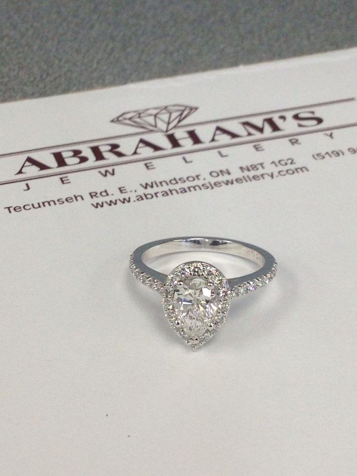 Pear shape diamond with halo engagement ring. Custom made. www.abrahamsjewellery.com