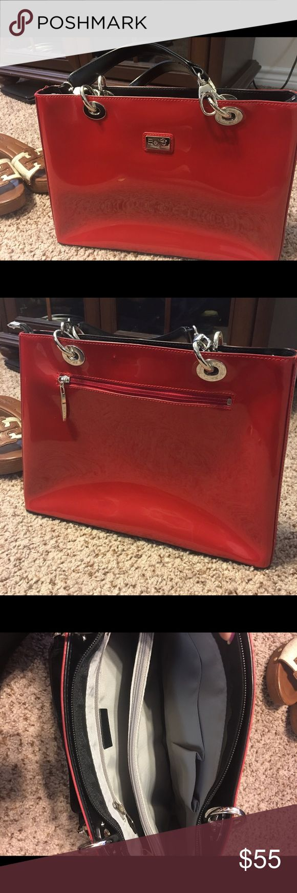 Beijo classic purse Beautiful Beijo red patented purse. 3 large compartments, 1 zipped & one outside pocket. Brand new.  Never used. beijo Bags Totes