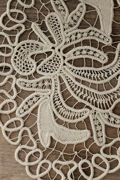 a beautiful example of point lace. oval in shape. unique free form pattern.  color is a rich taupe, but showing up a few shades lighter in photo. perfect for framing.    note: listing is for the ONE doily shown in photos 2-5.    measurements: 8 1/8 x 11 1/8 (taken from widest point)    if you are new to etsy and need help with the checkout process:  http://www.etsy.com/help_guide_checkout.php .