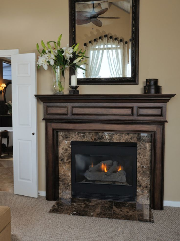 traditional master bedroom designed by carla aston featuring a dark stained dura supreme fireplace mantle