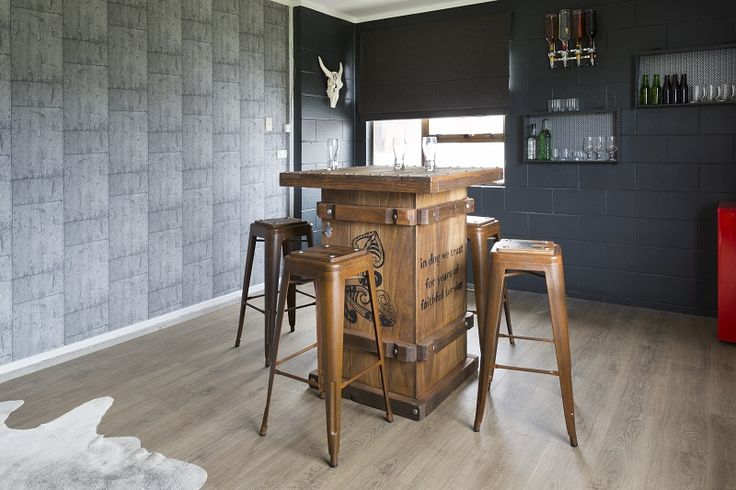 The final reveal! Dark charcoal paint, Dulux Titirangi with a feature 'metal-plate' look wallpaper, finished off with Expona Simplay vinyl planks in Light classic Oak colour. Decorating products are available in New Zealand through Guthrie Bowron stores.