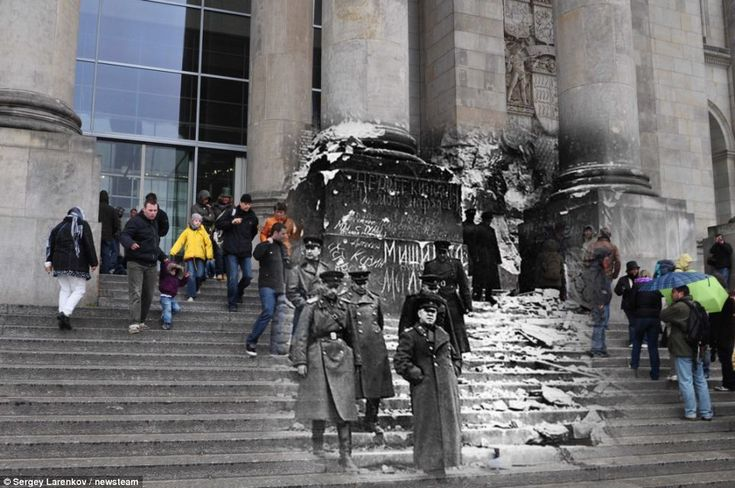 Generations: Tourists flock to the Reichstag in Berlin, where Russia's Marshal Zhukov stood in 1945    Read more: http://www.dailymail.co.uk/news/article-2116708/Russian-troops-storm-Reichstag-Extraordinary-images-merge-images-European-city-streets-war-peace.html#ixzz1pZxjnrT7    by Sergey Larenkov