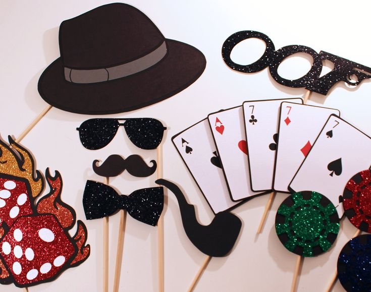 James Bond Themed Photo Booth Props - Features oversized deck of cards, glittered dice on fire, and more.... $50.00, via Etsy.