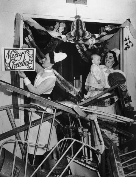 Nurses hanging Christmas decorations in a ward at Great Ormond Street Children's Hospital even though it had been damaged by several air raids, 5th December 1940. (Photo by William Vanderson/Fox Photos/Getty Images)