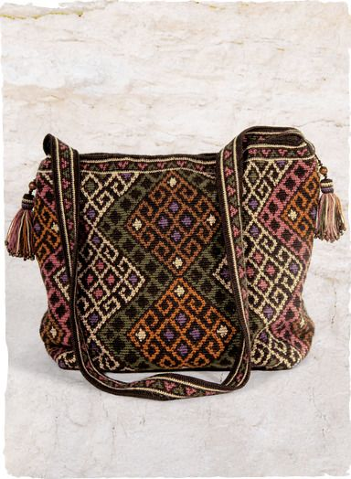 Superbly handcrocheted in scrolls from a Central Asian textile, with beaded tassels, cross-body strap and full lining. Inside pockets; zip/snap closure.