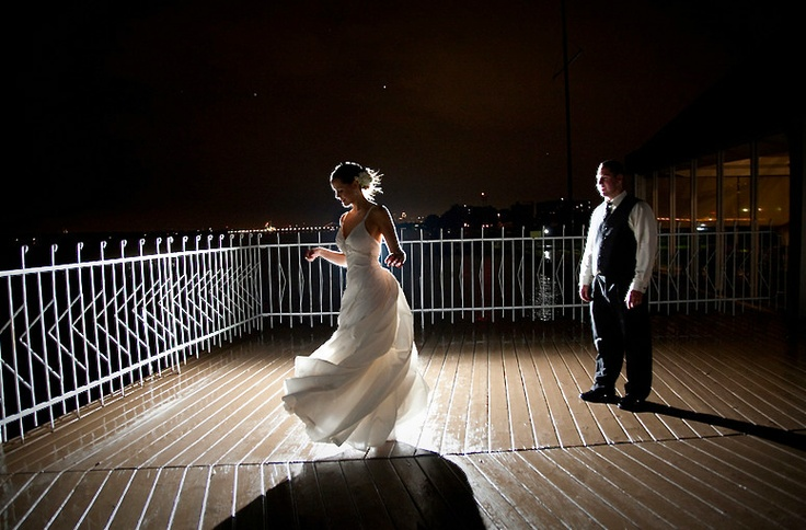 Bride dancing in the moonlight on the patio #wedding #dance #moonlight #roostertail #groom #tux #dress #bride