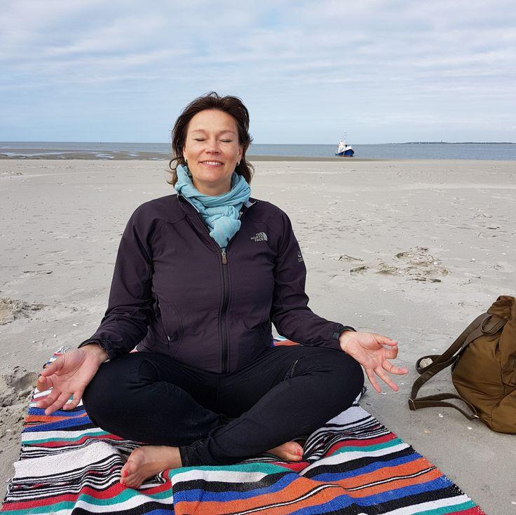Practicing yoga on a sandbank