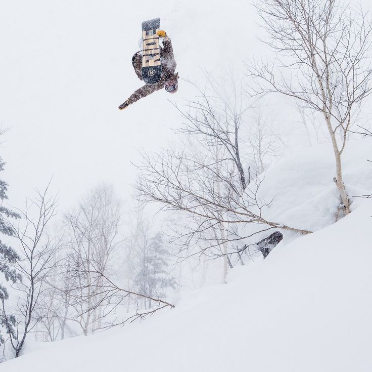 The snow is so deep in Japan you can literally land on your head and be okay. Luckily @littleyogurtbottle stomped this and didn't have to dig himself out. Photo: @andrew_miller #twsnow
