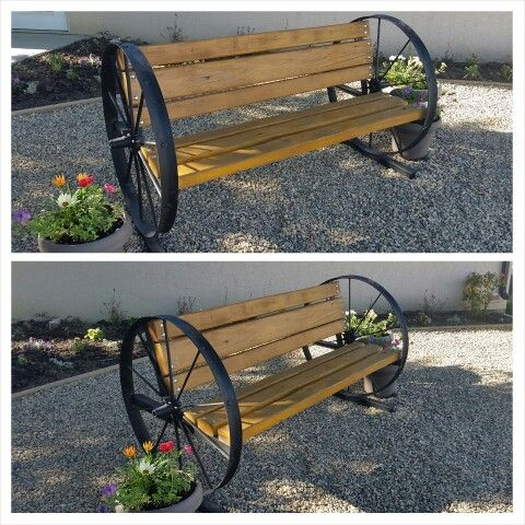 Old steel wheel bench with cedar boards
