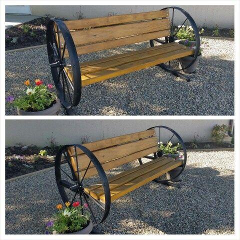 Old steel wheel bench with cedar boards