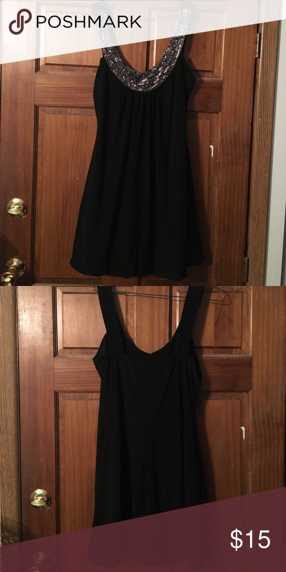 Little Black Dress Gathers at the bottom. Has beading along the neckline. Perfect for a special occasion or just a night out. Taboo Dresses Midi