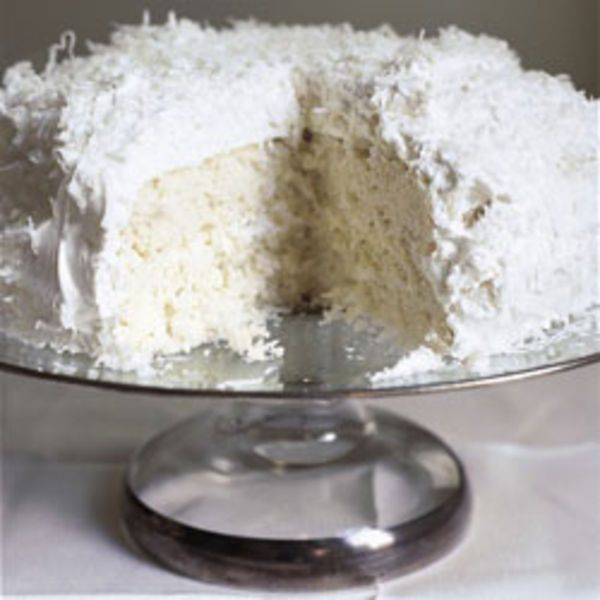 A cloud of fluffy, glossy white frosting doused in shredded coconut hides a moist white cake with rich coconut flavor.