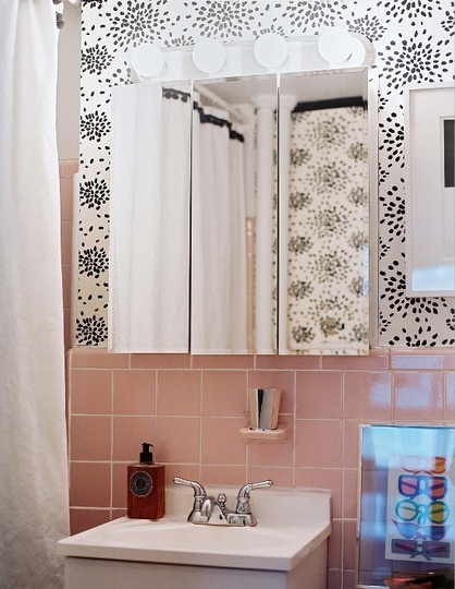 An idea to help tone down the pink bathroom until remodel.