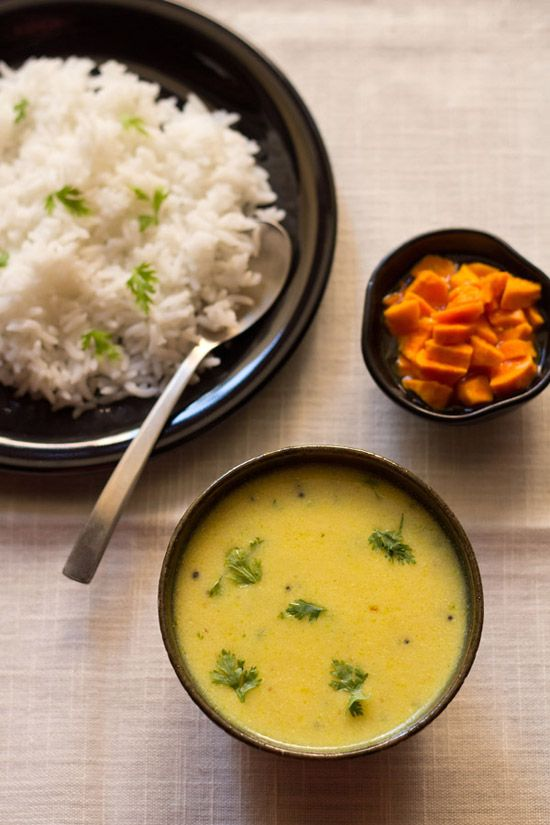 maharashtrian kadhi recipe - quick yogurt and gram flour based sauce or kadhi without pakoras. tempered with spices and a bit sweet. kadhi is best served with some steamed rice and makes for a simple summer meal.  #kadhi #yogurt
