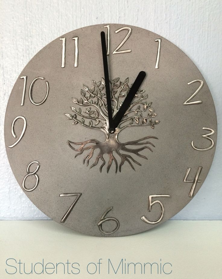 This magnificent clock was pewtered by Sim from our Wednesday class. Keeping the numbers and tree matt compliment the concrete clock perfectly. www.mimmic.co.za