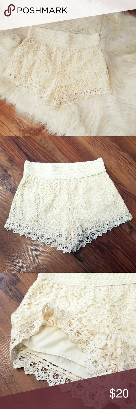 """A APPAREL   Cream Lace Shorts Brand New!   Beige/cream lace shorts feature an elastic fitted waist & are fully lined. Stretch to fit.  Made by: Ambiance Apparel Size: Small (2-4) Material: 65% cotton/35% nylon (self) & 100% polyester (lining) Measurements: 13.5"""" waist; 11"""" front rise; 13"""" back rise; 2"""" inseam (garment lying flat) Ambiance Shorts"""