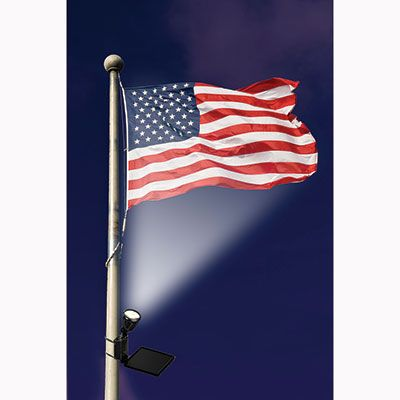 """Solar Powered Flag Light -$59.95- Wave the flag after dark According to the United States Flag Code, you can display the American flag at night if it is properly illuminated. This weatherproof Solar Powered Flag Light has an ultra bright LED lamp that is powered by a 6"""" x 6"""" crystalline solar panel. It mounts easily on any flagpole up to 4"""" in diameter with the included pole mounting bracket, no tools required. Let them see your flag 24 hours a day!"""