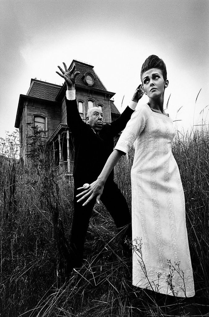 Hitch and model at the Psycho house, Harper's Bazaar, 1962