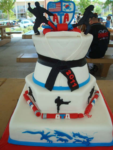 karate picnic and birthday cake - Cake for a huge picnic for this taekwondo academy as well as to celebrate several staff members birthdays. All done in mmf including the nunchucks, silhouettes and ATA patch. :)