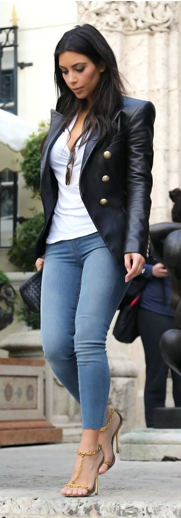 Kim Kardashian: Jacket – Balmain  Purse – Bottega Venetta  Shoes – Tom Ford