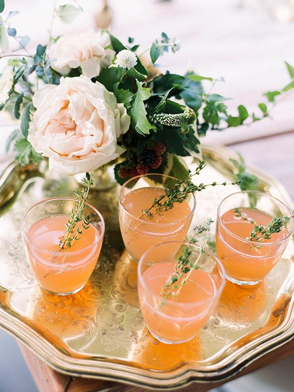 rosemary garnish on the cocktails | via; magnolia rouge