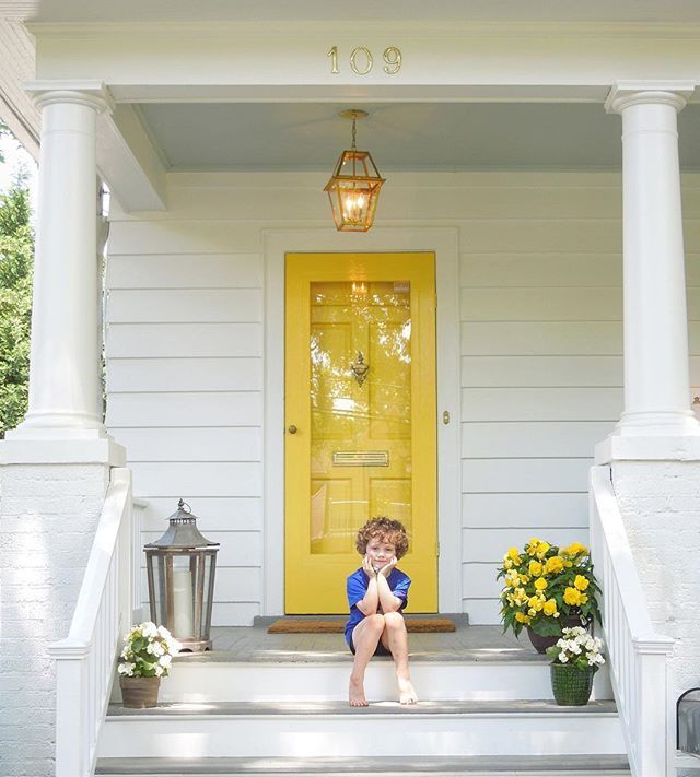 crisp white with bm yellow highlighter door. Gray porch floor and haint blue ceiling. . . tone on tone
