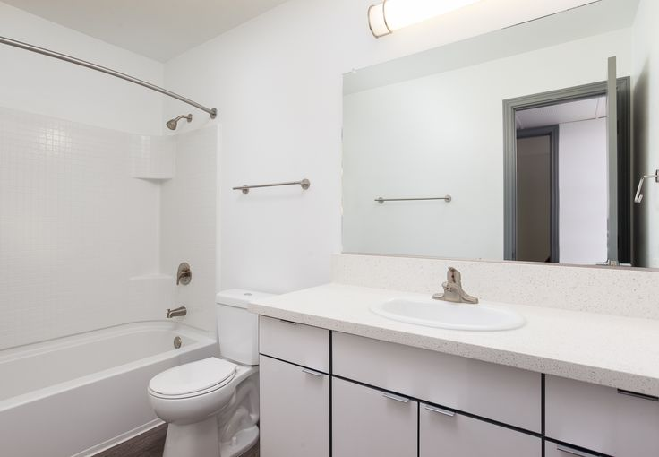 Renovated bathrooms and Quartz counter tops at Uptown Fullerton! | #UptownFullerton #Apartments #Fullerton #AMCLiving #LiveHappy #ApartmentIdeas #ApartmentsDecor #Apartmentliving #home #dreamhome #renovate #renovations