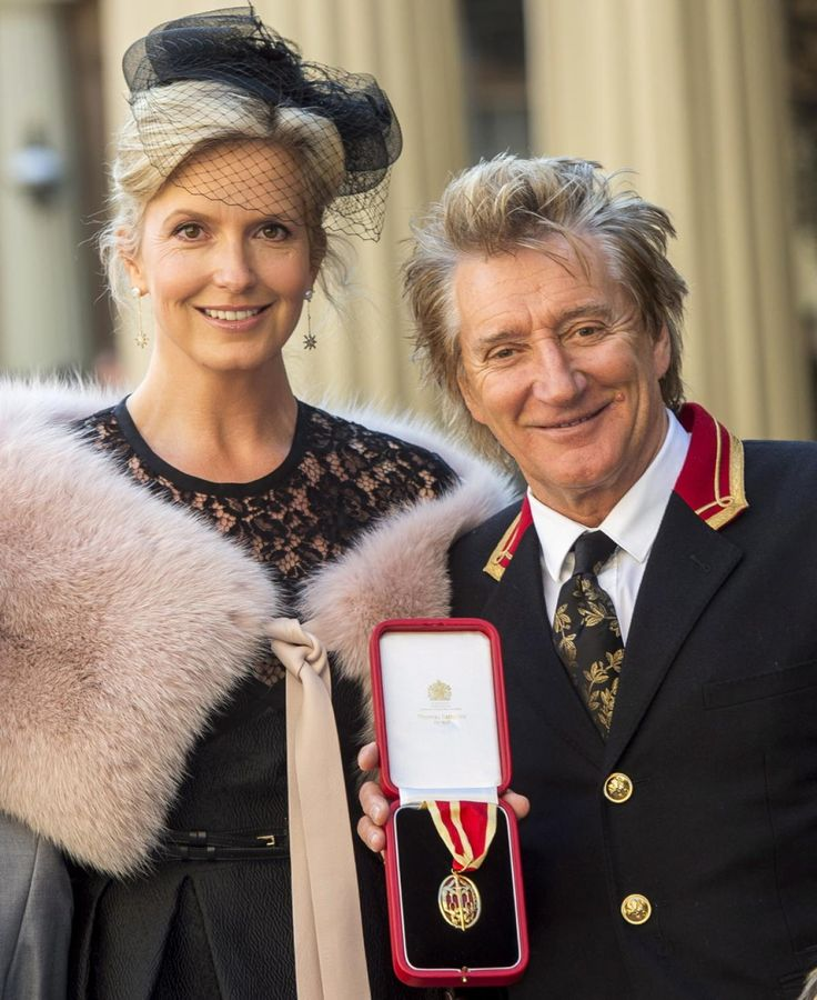 Rock singer Sir Rod Stewart showed off his medal after receiving his knighthood in London on Oct. 11, 2016. He was accompanied by his wife Penny Lancaster.