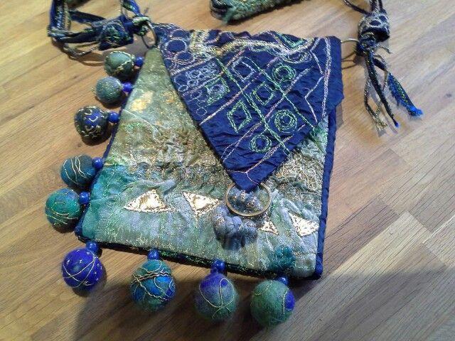 Bag. Metallic thead machine stitch.hand felted balls.