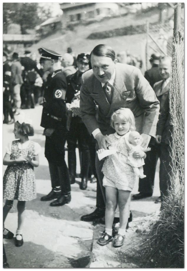 Hitler with a little girl. How much Der Führer loved the youth of his country.