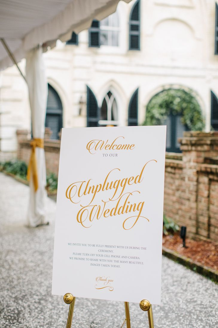 Gold and White Unplugged Wedding Sign | Shannon Michele Photography https://www.theknot.com/marketplace/shannon-michele-photography-charleston-sc-362066 | Boutique Planning https://www.theknot.com/marketplace/boutique-planning-charleston-sc-748777