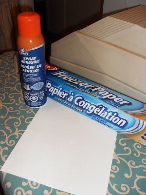 The shiny side of freezer paper will transfer images!  Stiffen it by gluing regular paper on the other side, then use it as your printer paper.
